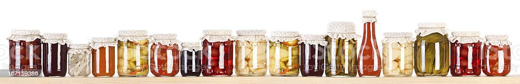 Long line of various preserves on a shelf stock photo