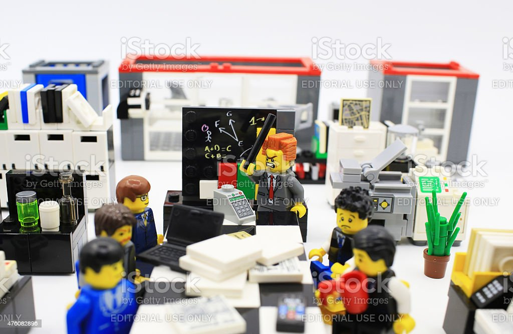 long meeting but everyone exhausting Hong Kong, Сhina - March 26, 2015:  Studio shot of Lego people in office, combine from different set. Legos are a popular line of plastic construction toys manufactured by The Lego Group in Denmark Lego Stock Photo