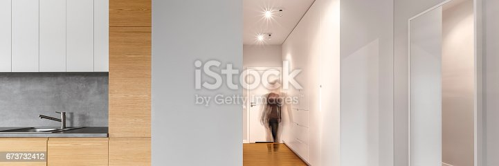 844050630 istock photo Long modern hallway 673732412