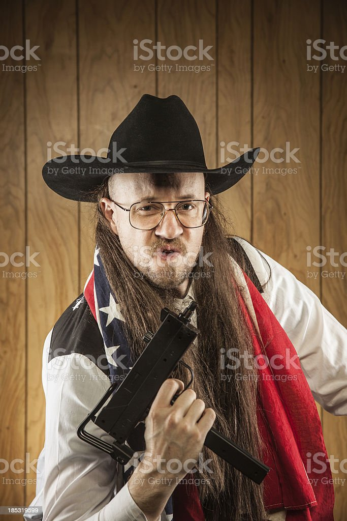 Long Mullet Redneck Cowboy with American Flag and Uzi Gun stock photo