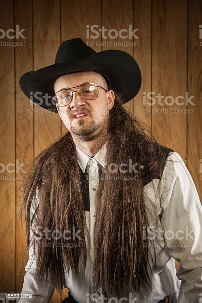 Long Mullet Redneck Hick Cowboy Wood Panelling Stock Photo - Download Image Now