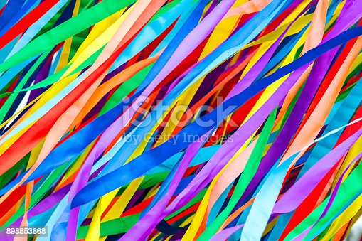 istock long multicolored ribbons is fluttering in the wind. festive background. 898853668