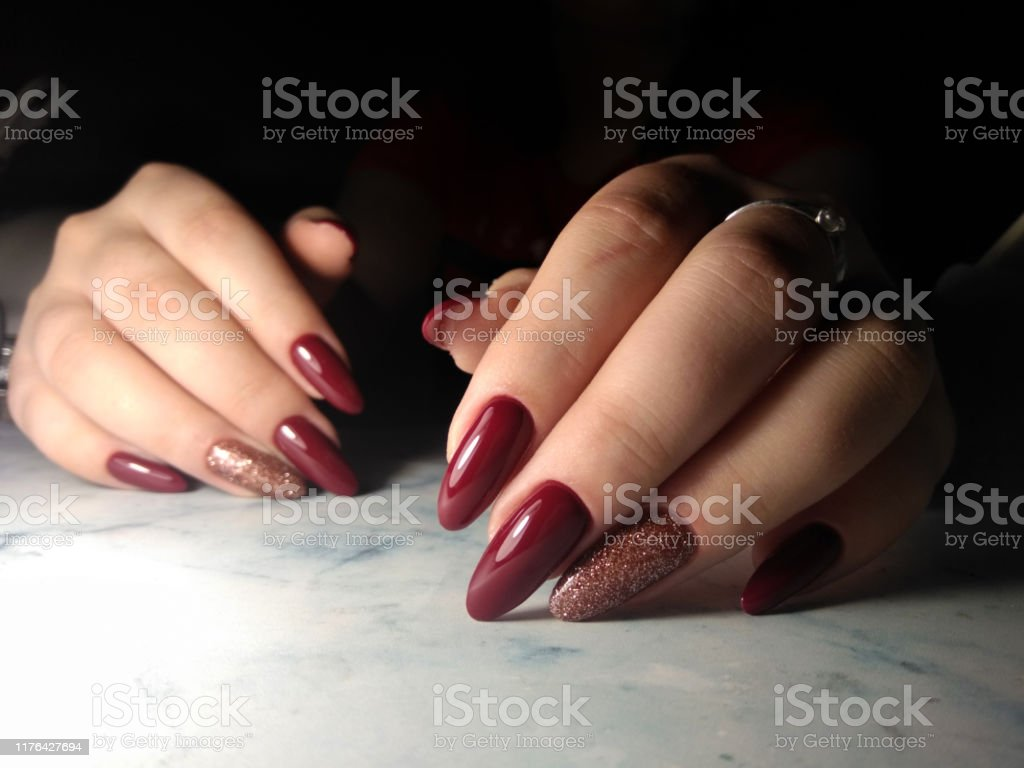 Long Nails Coated With Redwine Color Burgundy Gel Polish On Long Nails With Sequins Design Stock Photo Download Image Now Istock