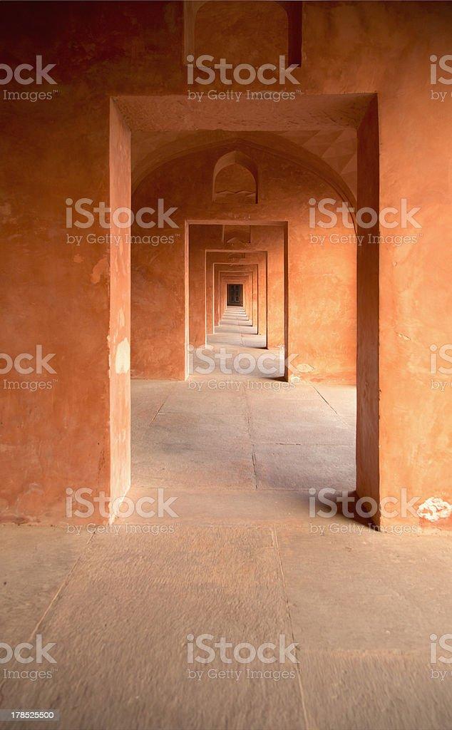 Long orange arcade in a building of Taj Mahal complex royalty-free stock photo