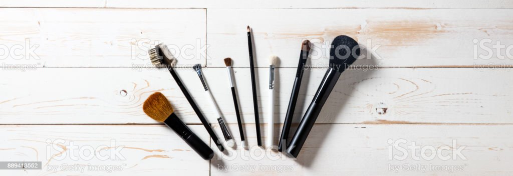 Long panorama for display of professional makeup brushes over wood stock photo