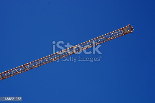 istock long part of arm machinery construction crane in front of blue sky 1133221237