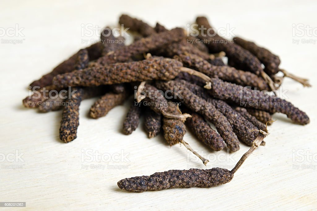 Long pepper or Pipli or Dipli (Piper longum) isolated on stock photo
