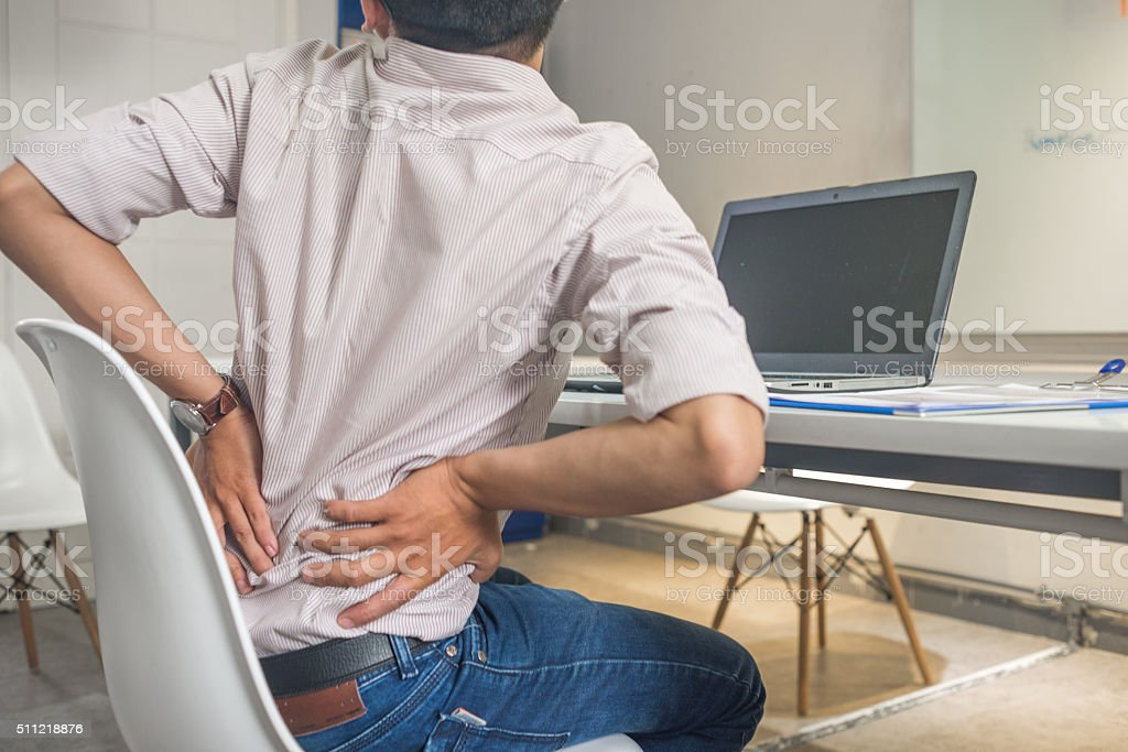 Long period of sitting will have bad impact to health stock photo