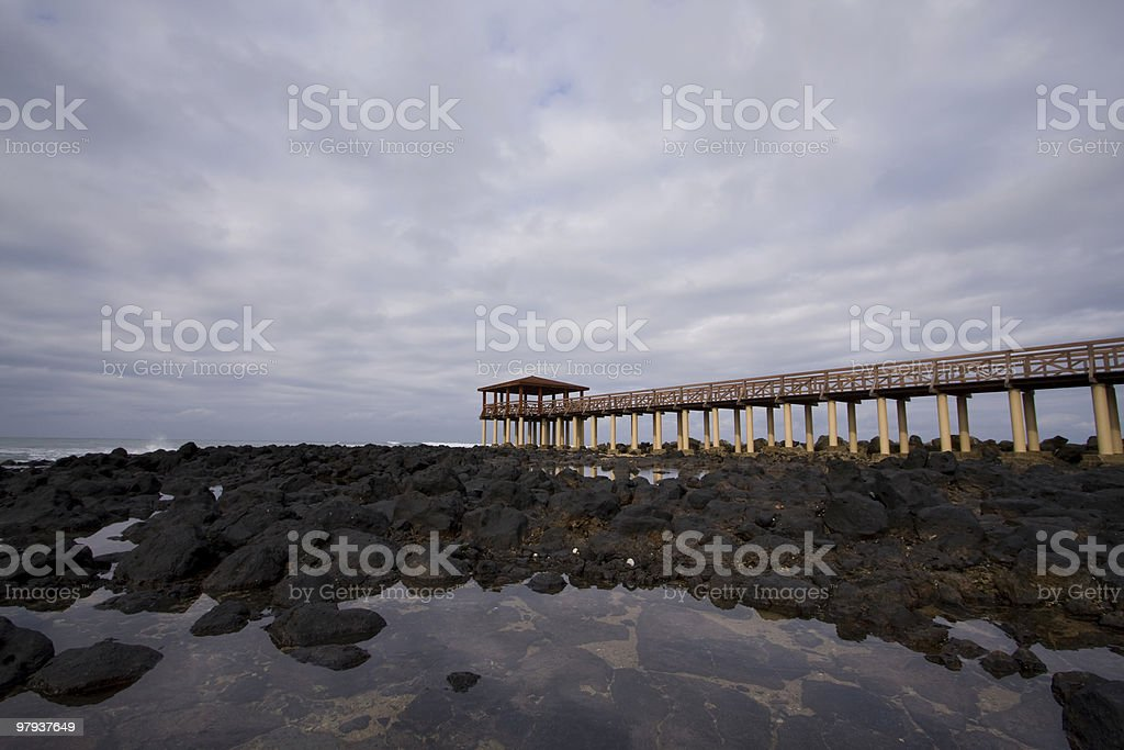 Long pier in a resort royalty-free stock photo