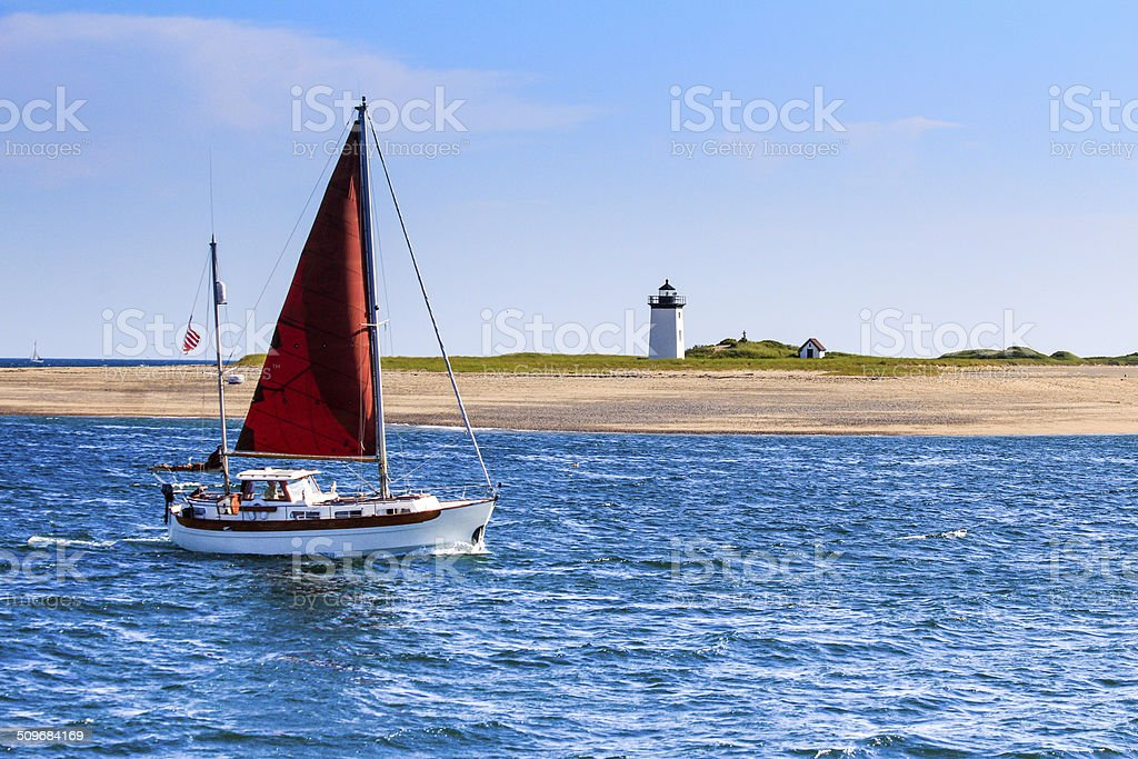 long point light and sailboat stock photo