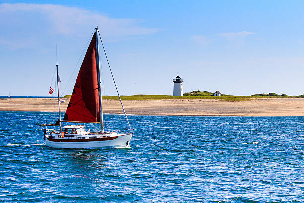 long point light and sailboat long point light and sailboat cape cod stock pictures, royalty-free photos & images