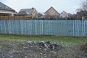 istock long private fence of blue color from wooden boards 1198309476