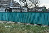 istock long private fence of green color from wooden boards 1198309247