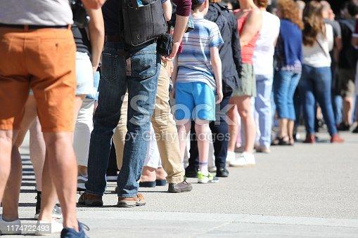 Long queue of people waiting in line