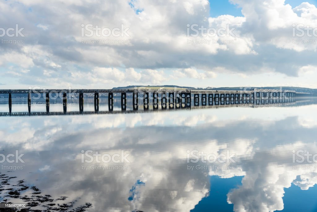 Long Railway bridge over a River with clouds reflecting in water - Royalty-free Architecture Stock Photo