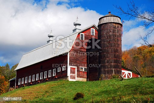 Pomfret, VT, USA October 10, 2012 A long barn stands on top of a hill on a late autumn day on a Pomfret, Vermont farm