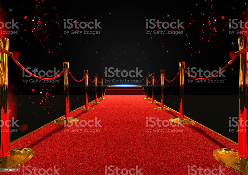 long red carpet between rope barriers with stair at the end stock photo