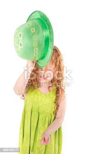 Little Girl Celebrating St. Patricks Day with Long Red Hair, Holding a green hat.