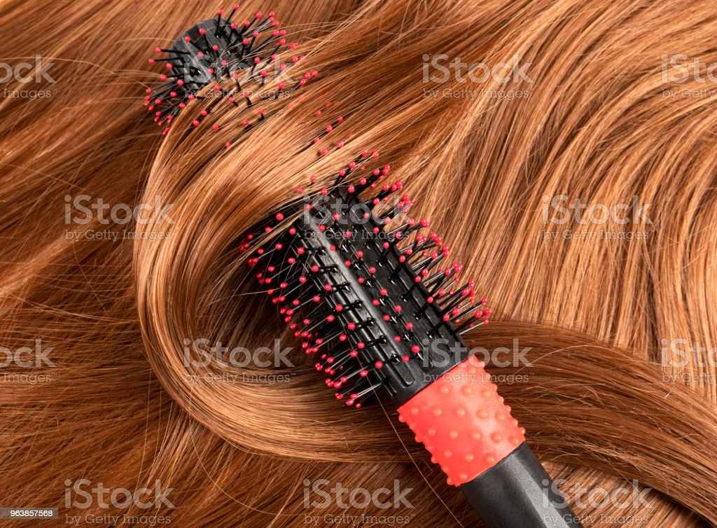 Long red human hair with a comb - Royalty-free Beauty Stock Photo