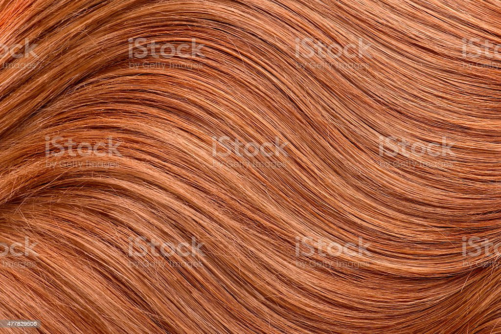 Long red human shiny hair stock photo