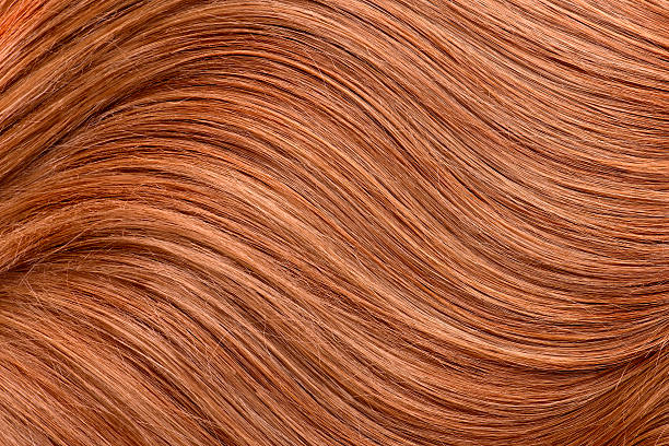 Long red human shiny hair Wavy red human hair background redhead stock pictures, royalty-free photos & images