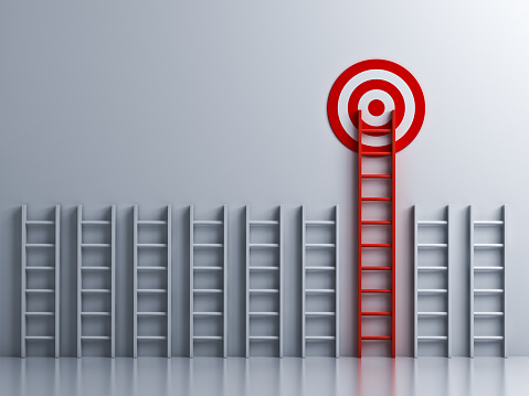 istock Long red ladder to goal target 931227330