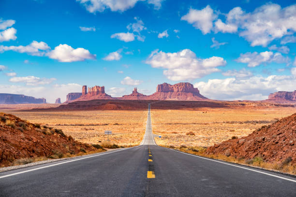 Long road at Monument Valley Utah side USA stock photo