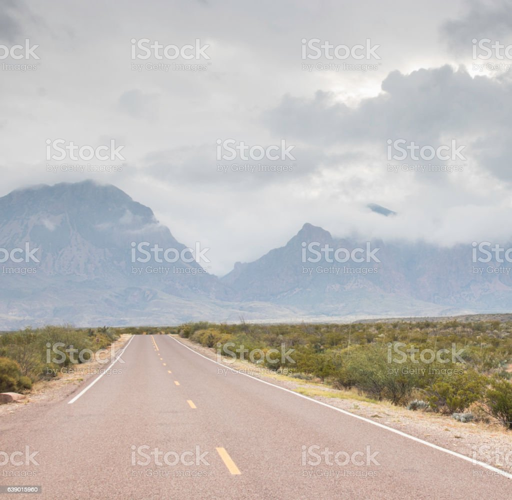 Long road to the mountains stock photo