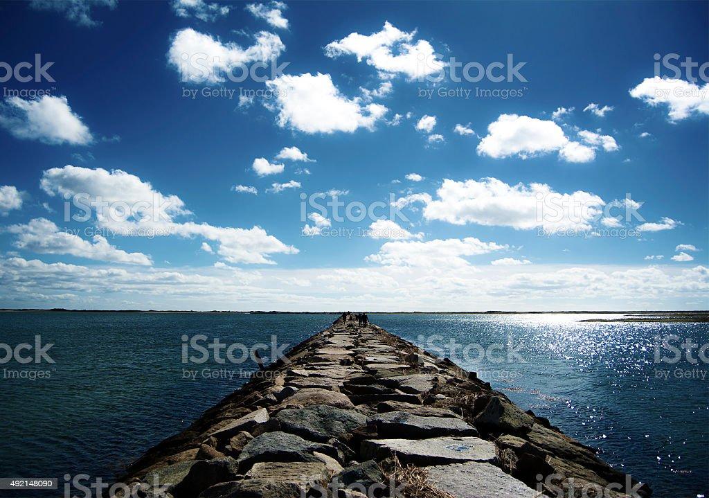 Long Rock Path through Ocean stock photo
