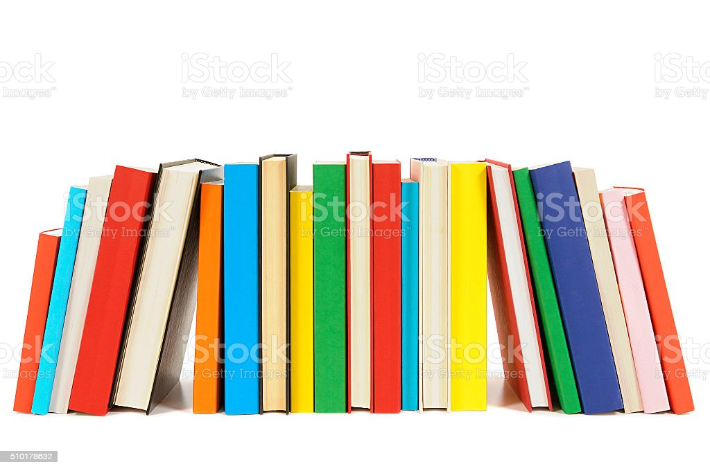 Long row of colorful library books isolated on white background stock photo