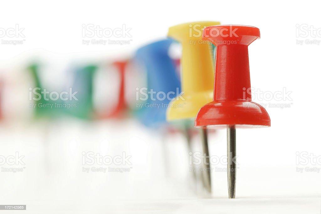 Long row of thumbtacks on white background royalty-free stock photo