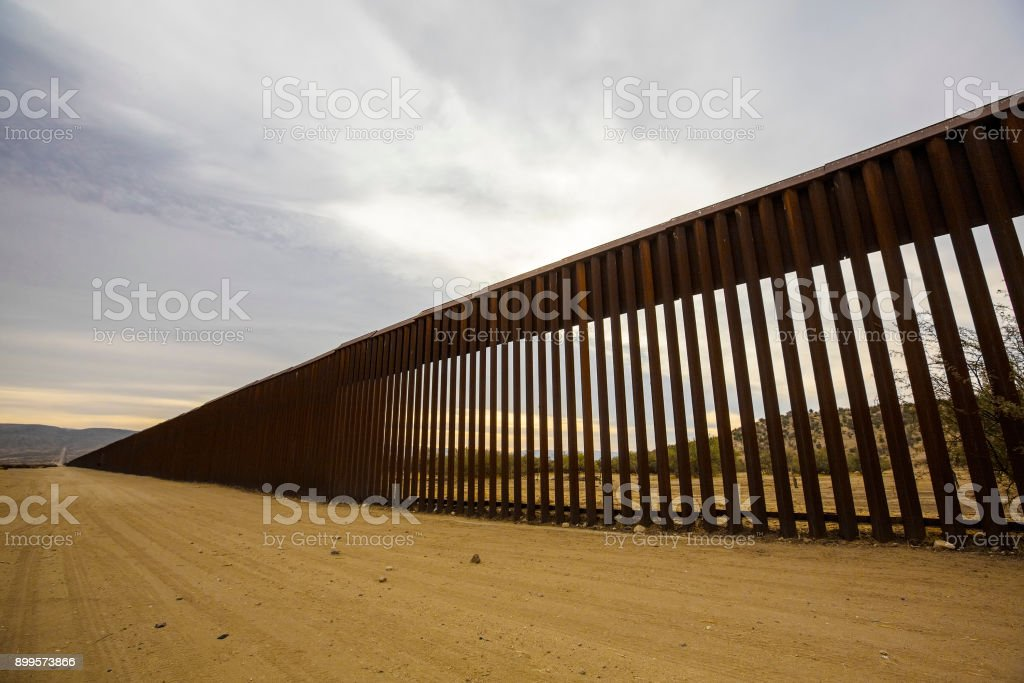 Long Section of United States Border Wall With Mexico stock photo