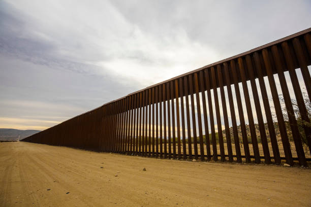 Long Section of United States Border Wall With Mexico Long section of the United States international border wall with Mexico international border barrier stock pictures, royalty-free photos & images