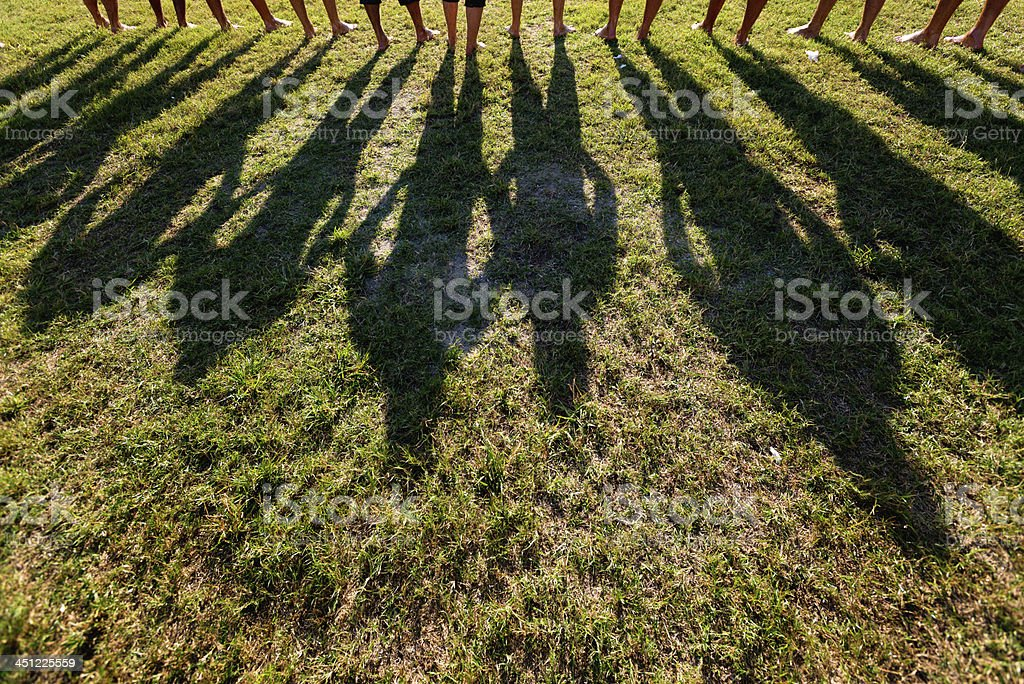 Long shadow on the green grass stock photo
