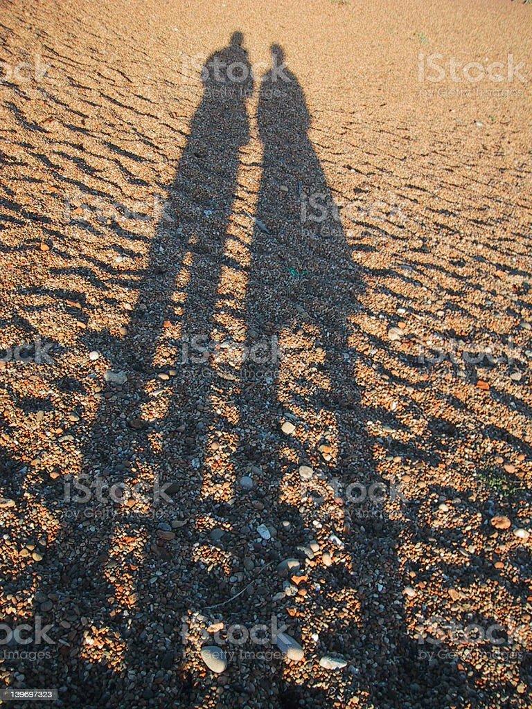 Long shadows on the beach stock photo