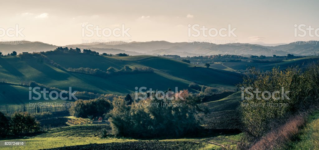 Long shadows on the soft hills. stock photo