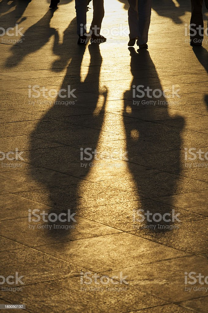 Long Shadows Walk into the Golden Sun royalty-free stock photo