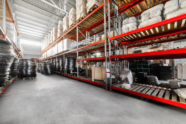 long shelves with a variety of boxes and container - material de construção imagens e fotografias de stock