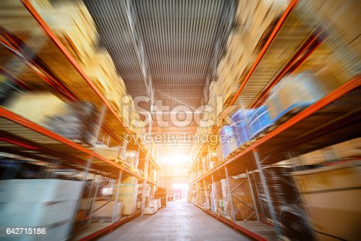 istock Long shelves with a variety of boxes and containers. 642715186