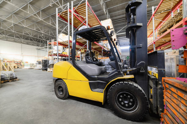 Long shelves with a variety of boxes and containers Warehouse industrial and logistics companies. Electric forklift. pallet jack stock pictures, royalty-free photos & images
