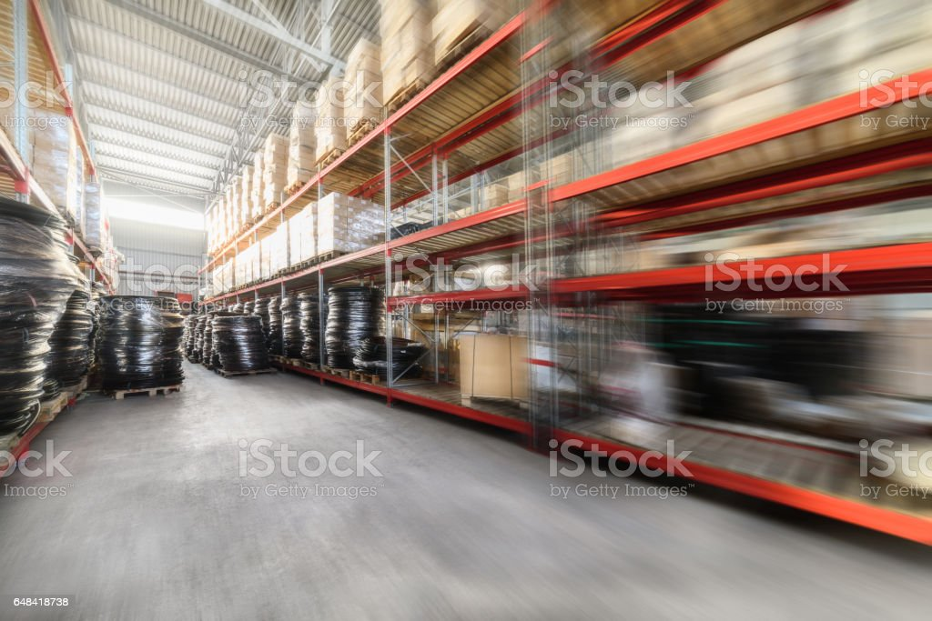 Warehouse industrial goods. Large long racks. Cardboard boxes and...