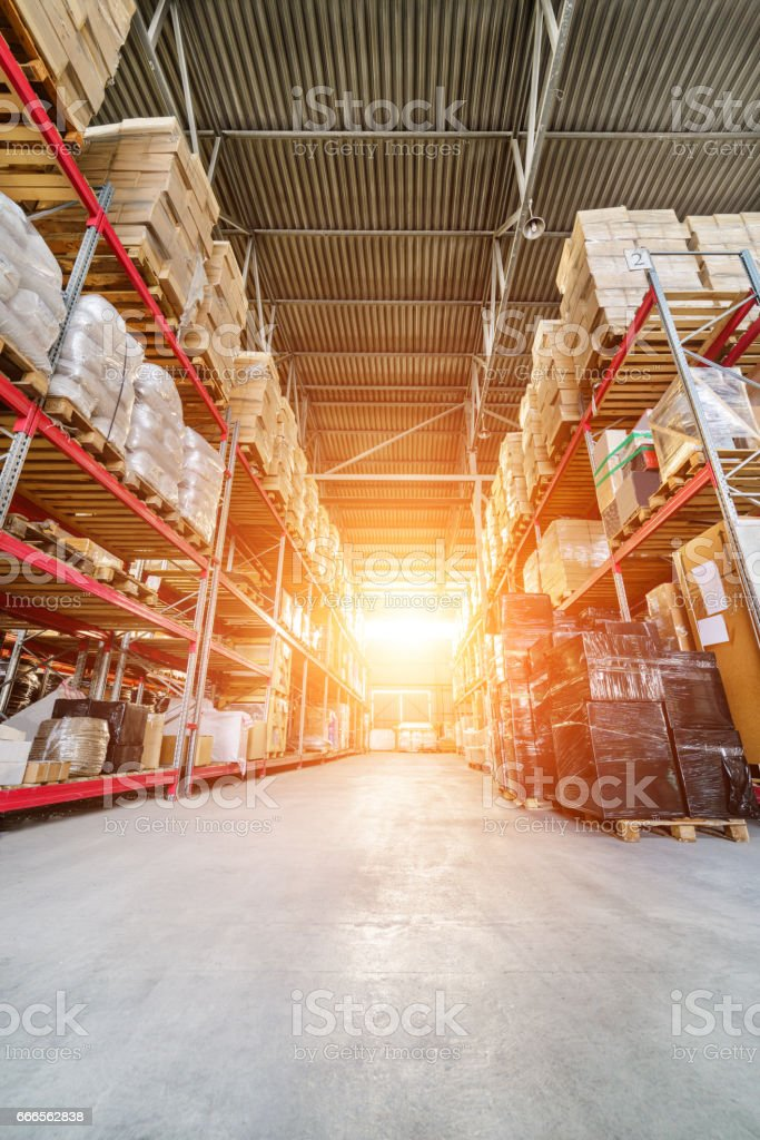 Large industrial warehouse. Shoot from a low point, bright sunlight.