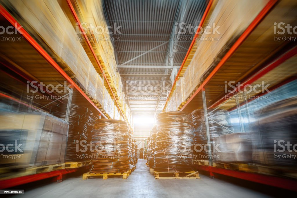 Long shelves with a variety of boxes and containers stock photo