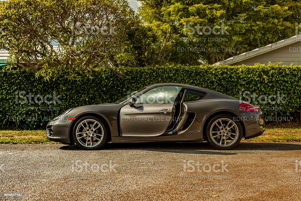 Long shot sideways. Porsche Cayman in residential area stock photo