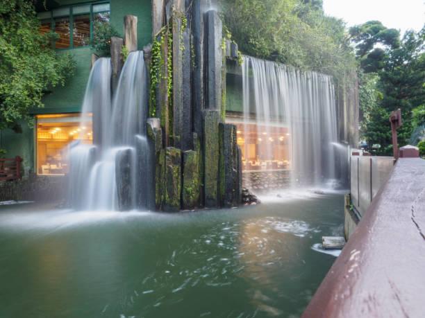 long shuttered image of the artificial waterfall at the nan lian garden in hong kong. - lian empty imagens e fotografias de stock
