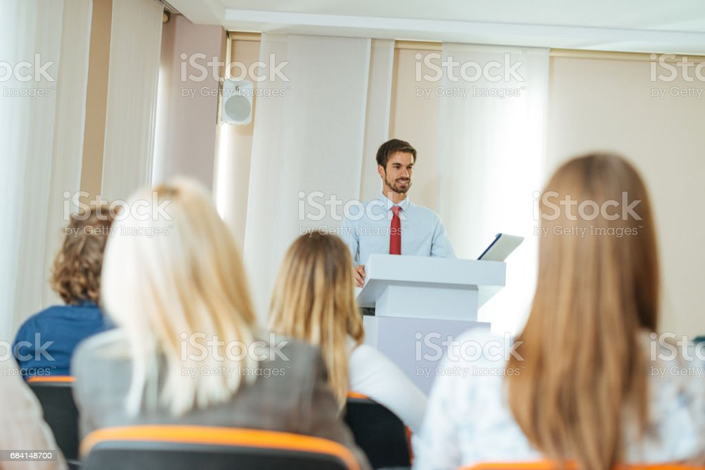Long speech in lecture hall by young professor foto de stock libre de derechos