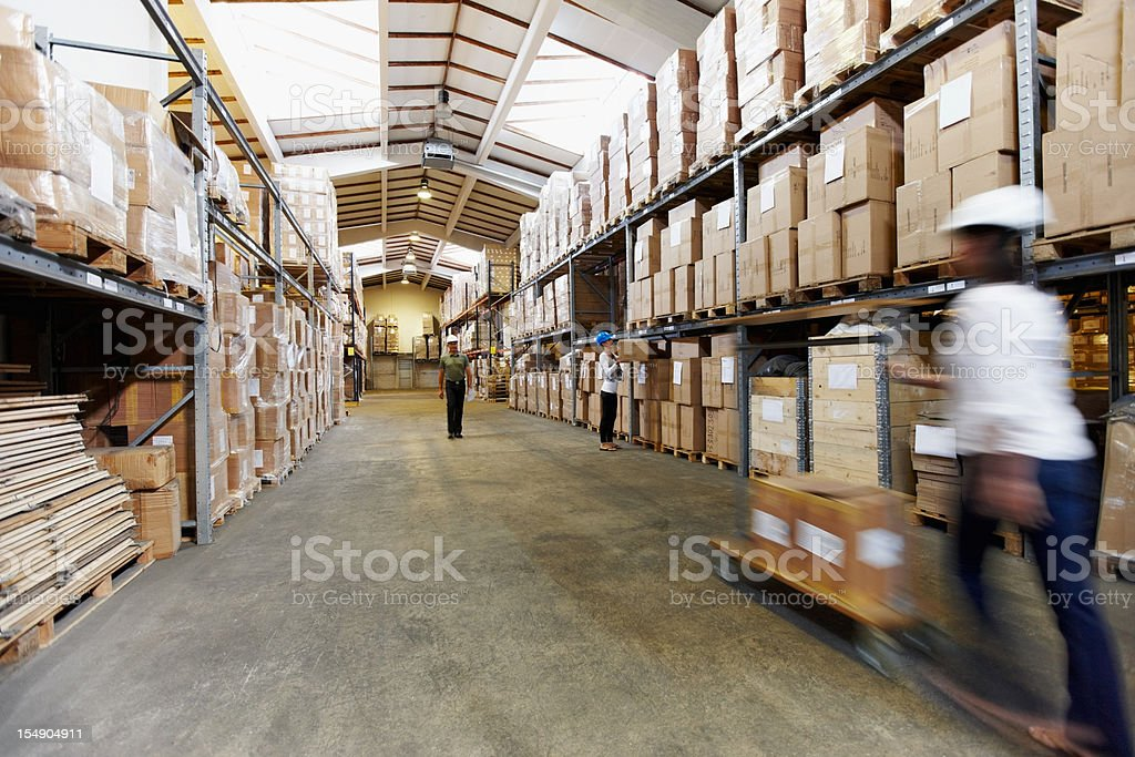 Long stack arrangement of goods in a wholesale warehouse depot royalty-free stock photo
