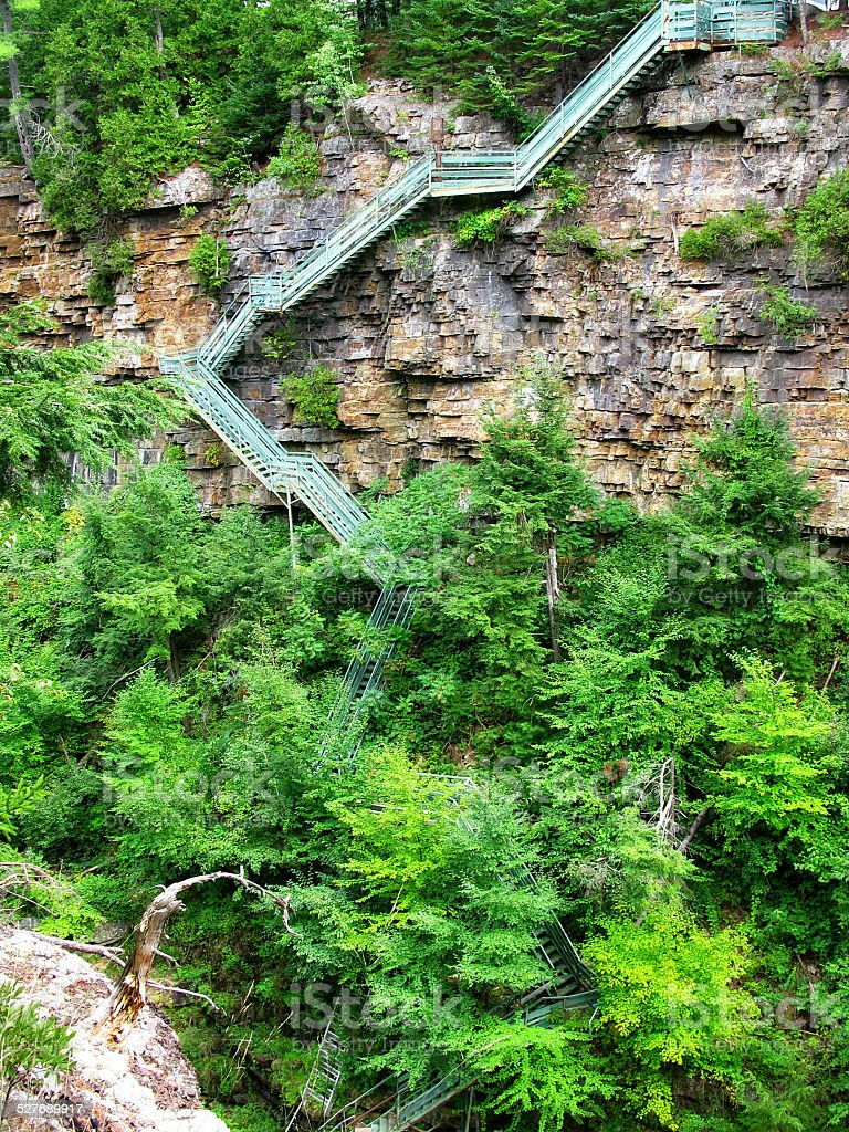 Long Staircase Down Rock Face at Ausable Chasm Gorge stock photo