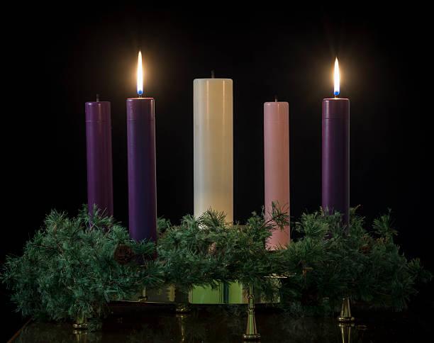 Long stick candles with wreath in the dark stok fotoğrafı