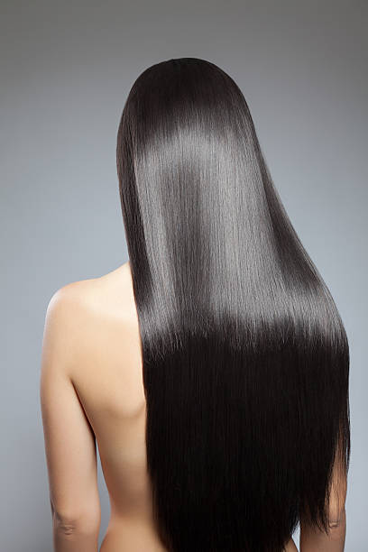 Long straight hair Back view of a woman with long straight hair straight hair stock pictures, royalty-free photos & images